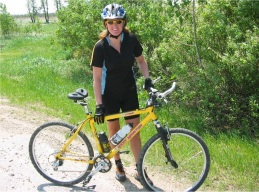 Karen and her bicycle with Spiderflex Seat-24 miles weekly