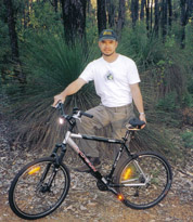 Mountain bike with Spiderflex noseless saddle - on a trail -Western Australia - Ren
